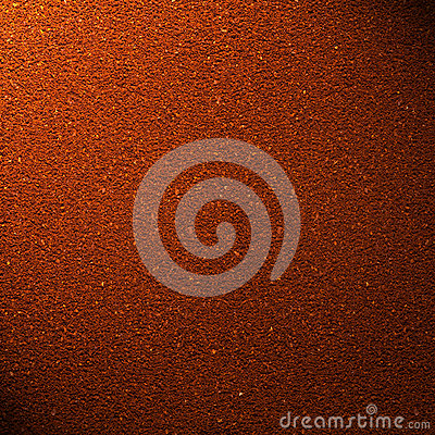 Ground coffee background with beam of light