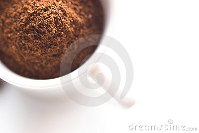 Ground coffee in white cup