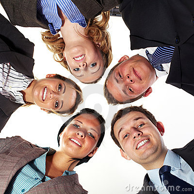 Group of 5 businesspeople in a circle, low angle