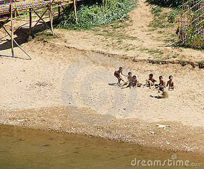 Group of Boys Playing on River Bank in Laos Editorial Stock Image