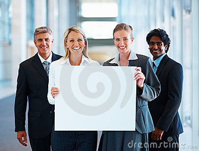 Group of business colleagues holding blank board