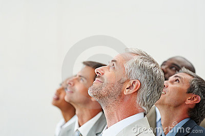 Group of business colleagues looking upwards