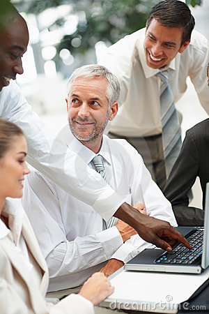 A group of business people enjoying while working