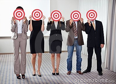 Group of business people holding a target