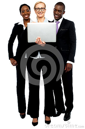 Group of business people looking into laptop