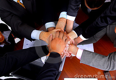 Group of business people making a pile of hands