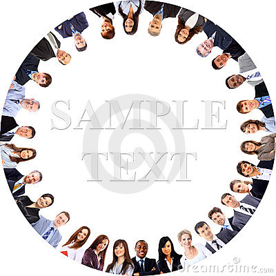 Group of business people standing in huddle, smiling, low angle