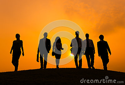 Group of Business People Walking in Back Lit