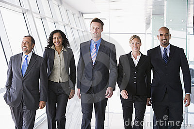 Group of business people walking towards camera