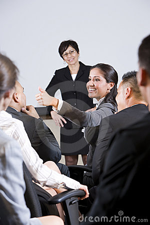 Group businesspeople, focus on woman in audience