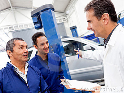Group of car mechanics