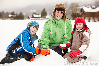 Group Of Children Building Snowman