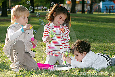 Group of children doing soap bubbles