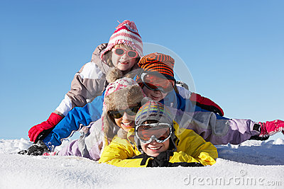 Group Of Children Having Fun On Ski Holiday