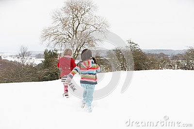 Group Of Children Having Fun In Snow