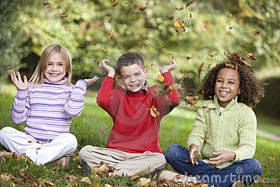 Group of children playing in leaves
