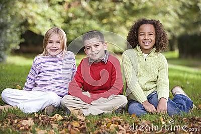 Group of children sitting in garden