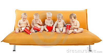 Group of children sitting on sofa, eating popcorn