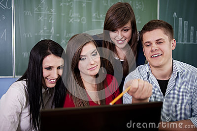 Group of college students using laptop
