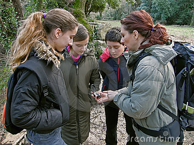 Group with compass in nature