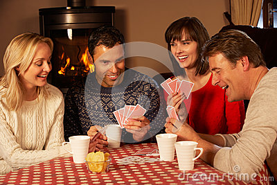 Group Of Couples Playing Cards Together