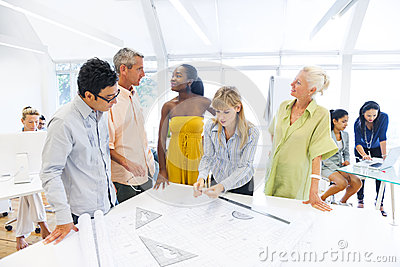 Group of Design Team in a Design Studio Working on New Project