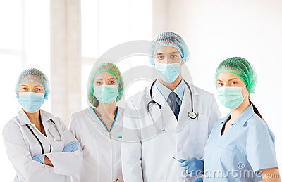 Group of doctors in operating room