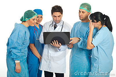 Group of doctors using laptop
