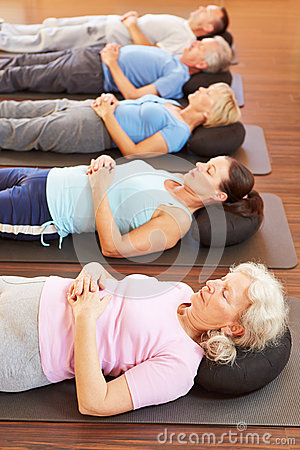 Group doing relaxation exercise