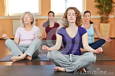 Group doing relaxing yoga exercises