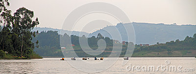 Group of Dugout Canoes Paddle Away Editorial Stock Photo