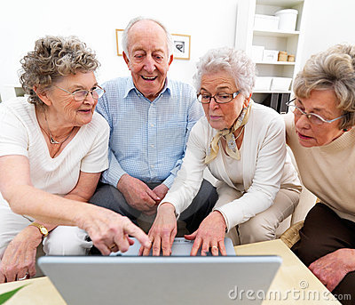 Group of elderly people working on laptop