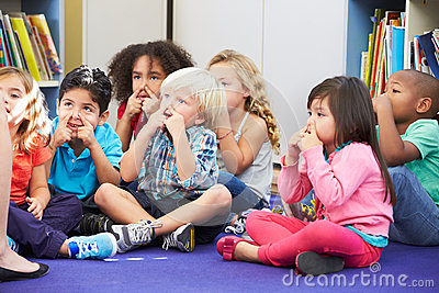Group of Elementary Pupils In Classroom Touching Noses