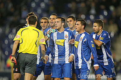 Group of Espanyol players speak with referee Editorial Image