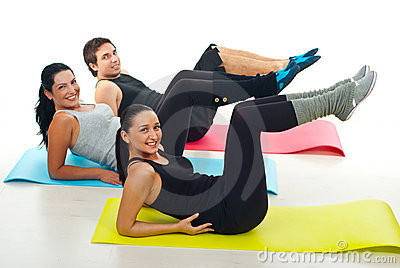Group exercising on colorful mats
