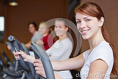 Group exercising on crosstrainer
