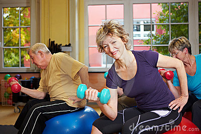 Group exercising with dumbbells