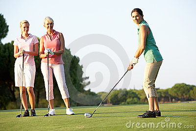 Group Of Female Golfers Teeing Off
