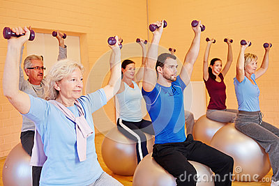 Group in fitness center doing
