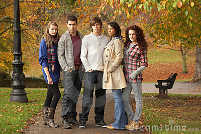 Group Of Five Teenage Friends Having Fun In Autumn