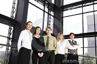 A group of five young businesspersons in an office