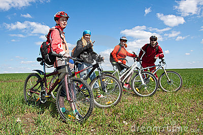 A group of four adults on bicycles.