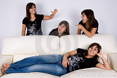 Group of four twins having fun indoors