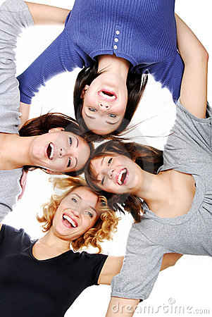 Group of four young adult happy girls