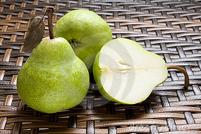 Group Of Fresh Pears With One Halved