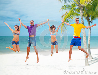 Group of friends or couples jumping on the beach