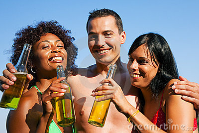 Group of friends drinking beer in swimwear