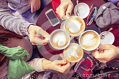 Group of friends drinking cappuccino at coffee bar restaurant Stock Photo