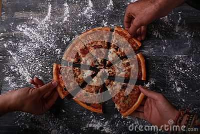 Group of friends eating pizza Stock Photo