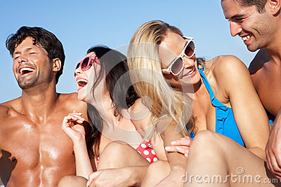 Group Of Friends Enjoying Beach Holiday